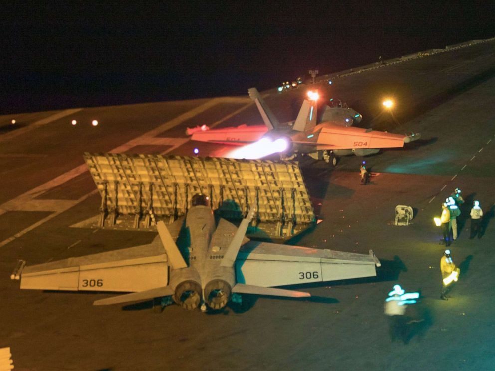 A handout photo made available by the US Navy showing a US F/A-18E Super Hornet from the Sidewinders of Strike Fighter Squadron 86 launced from the flight deck of the Nimitz-class aircraft carrier USS Abraham Lincoln in the Red Sea on May 10, 2019.