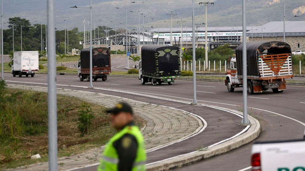Cargo trucks containing humanitarian aid from the U.S for Venezuela arrive at the International Bridge Tienditas, near Cucuta, Colombia, on the border with Venezuela, Feb. 7, 2019. Venezuela's opposition leaders requested the shipments and vowed to bring them inside the troubled nation despite objections from embattled President Nicolas Maduro.