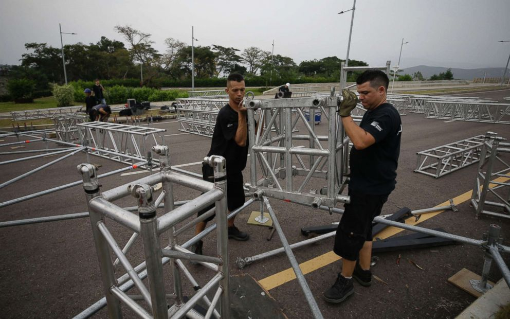PHOTO: Workers prepare the area for the upcoming Venezuela Aid Live concert at the Tienditas International Bridge on the outskirts of Cucuta, Colombia, on the border with Venezuela, Feb. 20, 2019.