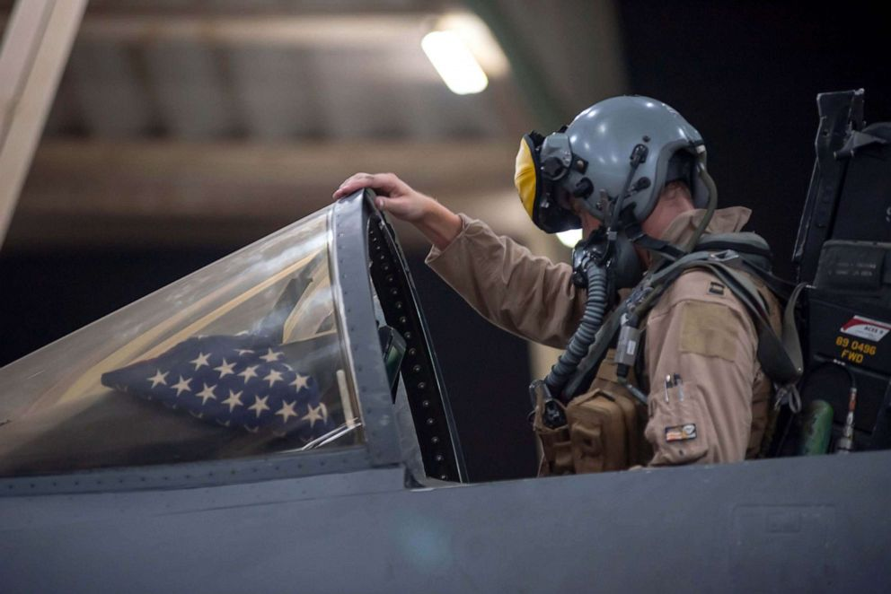 PHOTO: A pilot works in the cockpit at a U.S. military site.
