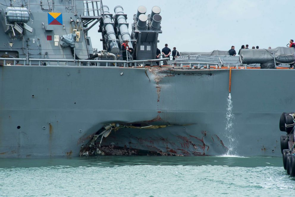 Damage to the port side is visible on the Guided-missile destroyer USS John S. McCain following a collision with the merchant vessel Alnic MC while underway east of the Straits of Malacca and Singapore on Aug. 21, 2017.