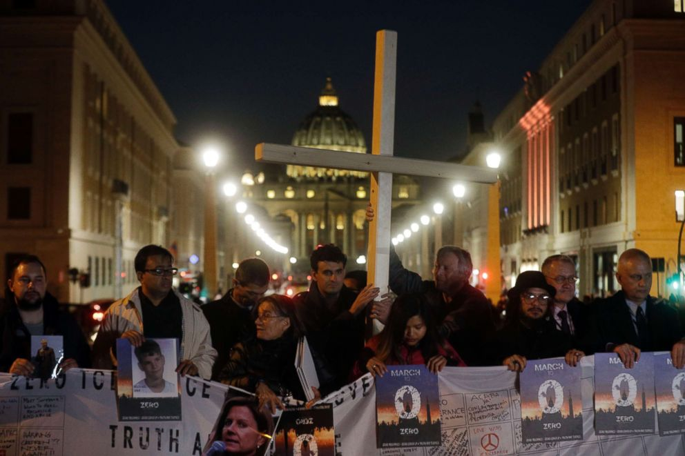 PHOTO: Survivors of sex abuse hold a cross as they gather in front of the road leading to St. Peters Square, during a vigil for the victims of sex abuse, in Rome, Feb. 21, 2019.