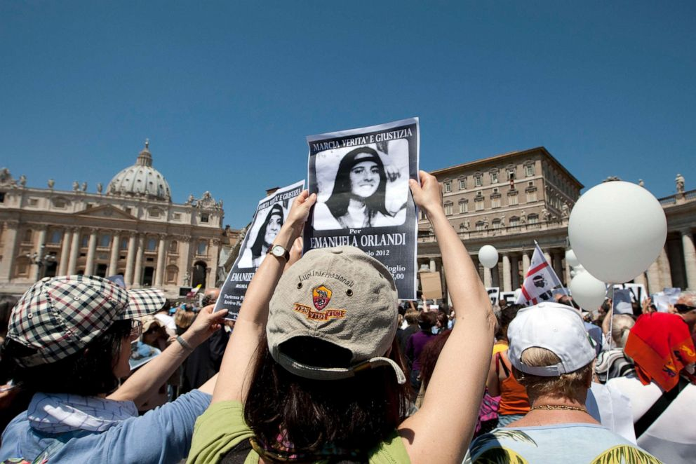 PHOTO: In this Sunday, May 27, 2012 file photo, people hold pictures of Emanuela Orlandi reading, march for truth and justice for Emanuela in St. Peters square, at the Vatican.