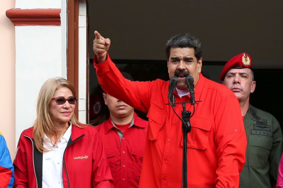 Venezuela's President Nicolas Maduro attends a rally in support of his government and to commemorate the 61st anniversary of the end of the dictatorship of Marcos Perez Jimenez next to his wife Cilia Flores in Caracas, Venezuela, Jan. 23, 2019.