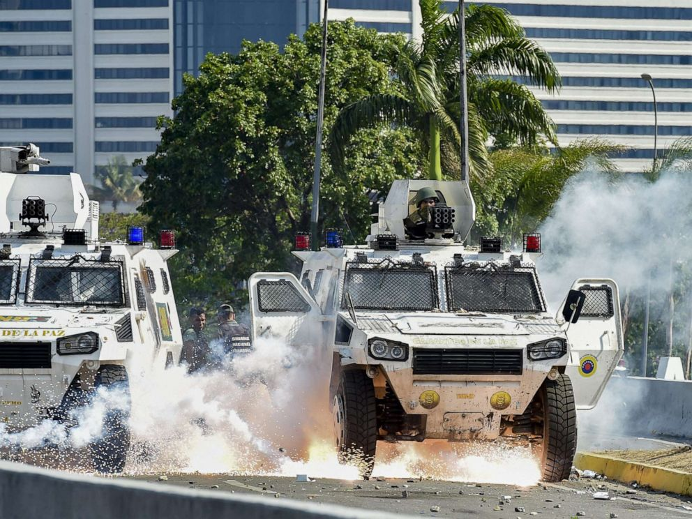 PHOTO: An explosion occurs under a military vehicle during clashes between forces loyal to Venezuelan President Nicolas Maduro and opposition demonstrators in Caracas on April 30, 2019.