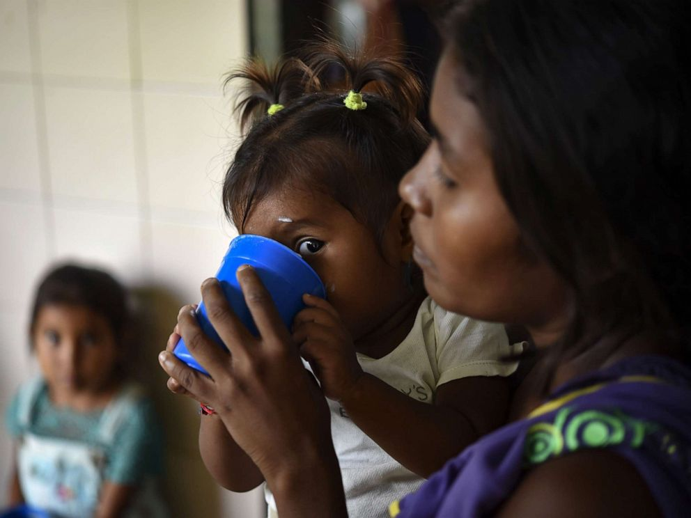 PHOTO: Yukpa indigenous children, some of them suffering from malnutrition, are fed with supplements provided by CARITAS organization, at Los Angeles del Tukuko mission, near Machiques, Zulia state, Venezuela, July 5, 2019.