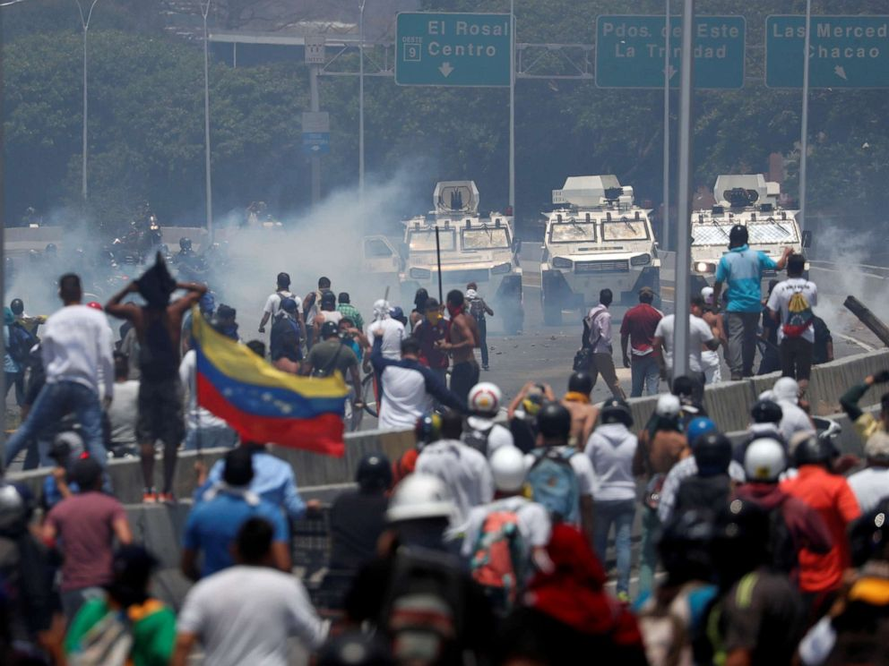 PHOTO: Opposition demonstrators face military vehicles near the Generalisimo Francisco de Miranda Airbase La Carlota in Caracas, Venezuela April 30, 2019.