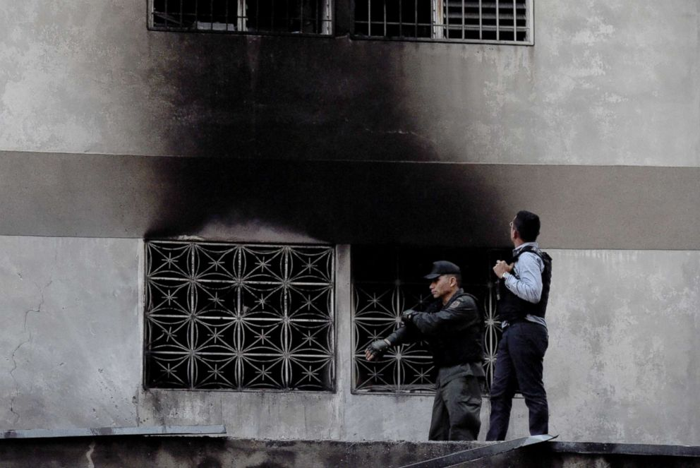PHOTO: Security forces check a building after an explosion was heard during a ceremony attended by Venezuelan President Nicolas Maduro in support of the National Guard in Caracas on August 4, 2018.