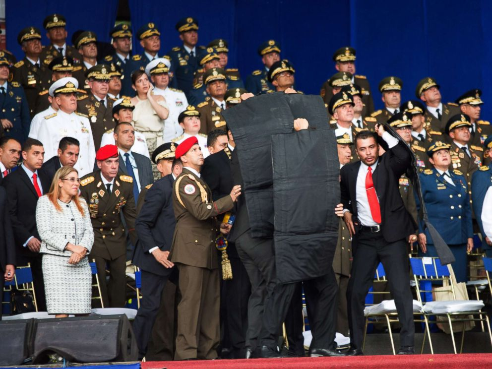 PHOTO: Security members surround and protect Venezuelan President Nicolas Maduro after his speech was interrupted in Caracas, Venezuela, on Aug. 4, 2018.  5 major headlines to start the week venezuela attack 04 nc jrl 180804 hpMain 4x3 992