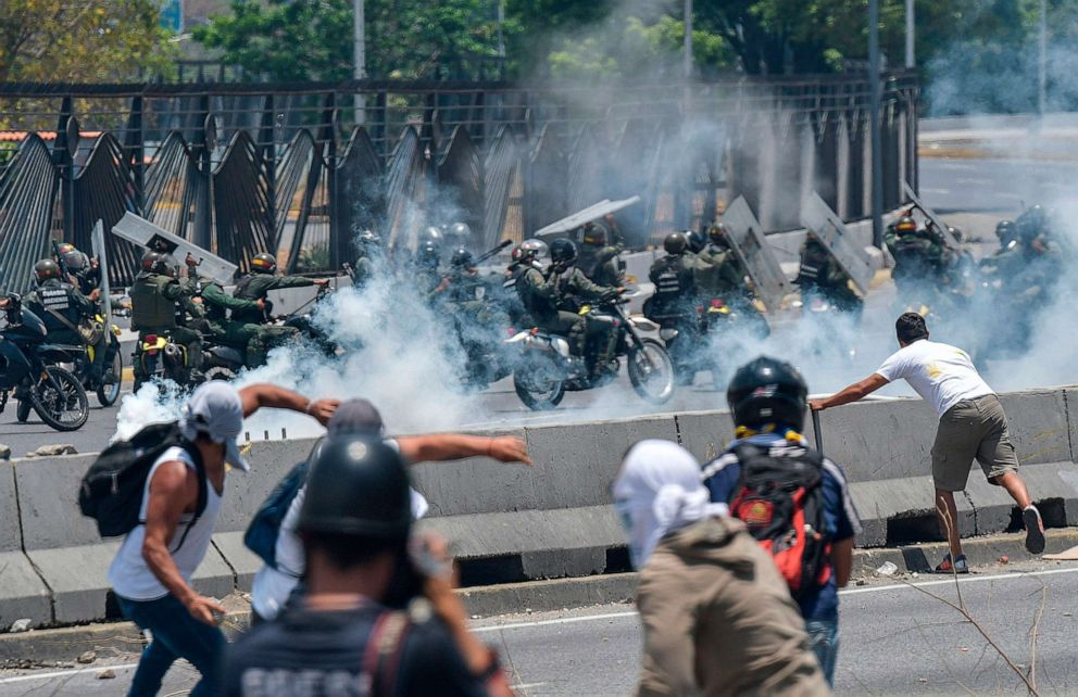 PHOTO: Anti-government protesters clash with security forces near La Carlota military base in Caracas, Venezuela during the commemoration of May Day on May 1, 2019.