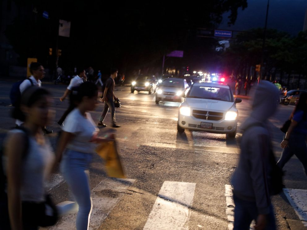 PHOTO: People cross a street during a blackout in Caracas, Venezuela, Monday, July 22, 2019.
