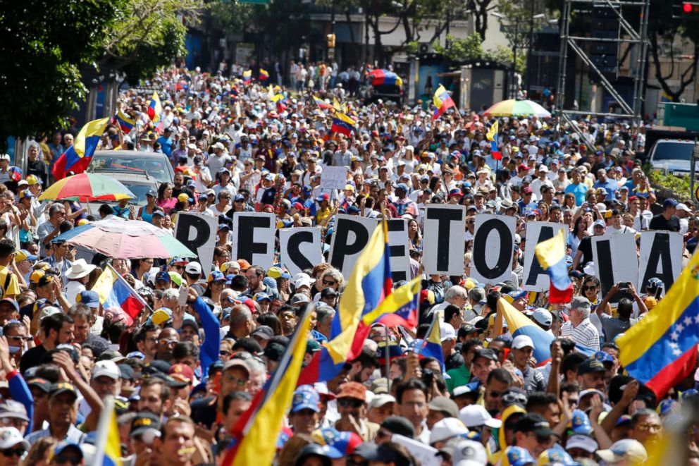 Hundreds of people march in Caracas, Venezuela, Feb. 12, 2019, in opposition to the government of President Maduro.