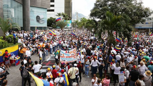 Venezuelans take to streets on independence day with dueling rallies, military out in force