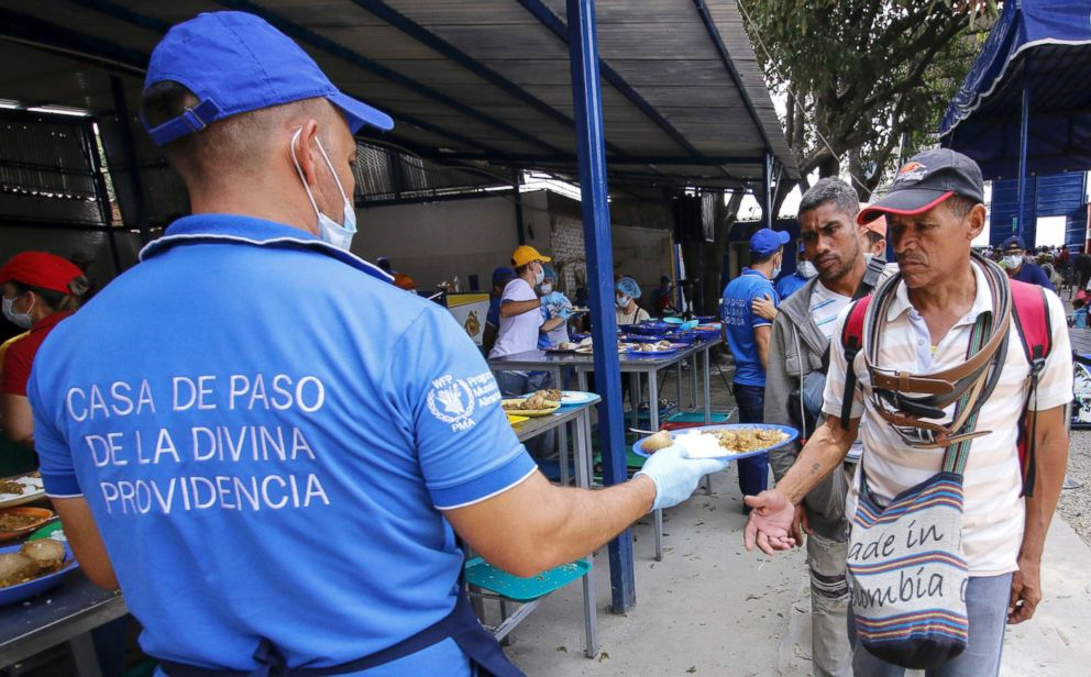 Venezuelan migrants are served a meal at the Divina Providencia migrant shelter in Cucuta, Colombia, on the border with Venezuela, Feb. 7, 2019.