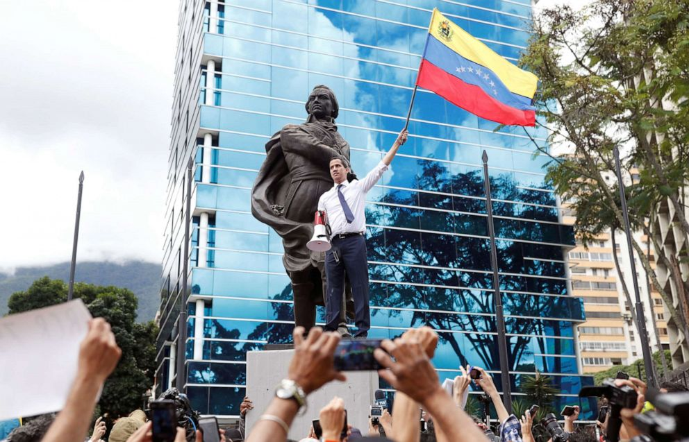 PHOTO: Venezuelan opposition leader Juan Guaido, who many nations have recognised as the countrys rightful interim ruler, waves a Venezuelan national flag at a rally in Caracas, Venezuela, July 5, 2019.