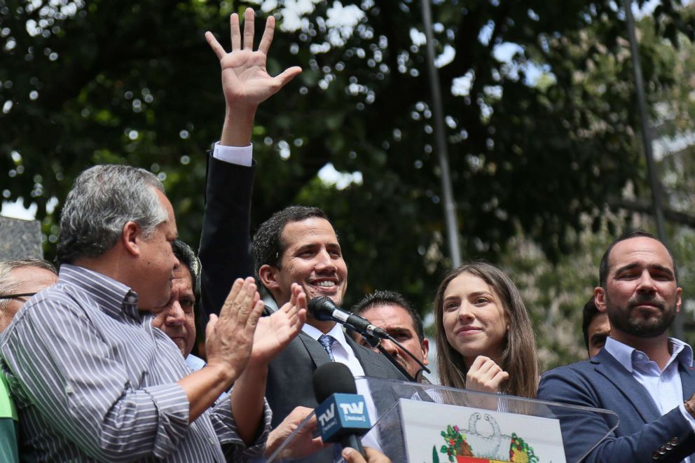 PHOTO: Juan Guaido, who has appointed himself interim president waves to supporters at Plaza Bolivar of Chacao, Jan. 25, 2019 in Caracas, Venezuela.