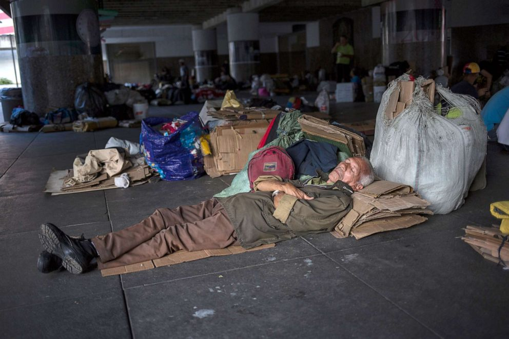 PHOTO: A man sleeps in front of the Venezuelas Central Bank to protest an unpaid retirement bonus for oil workers, in Caracas, Venezuela, July 16, 2019.