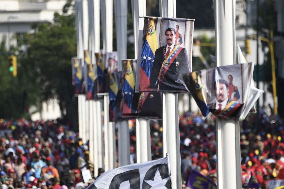 PHOTO: Posters depicting Venezuelan President Nicolas Maduro are seen during a May Day rally in Caracas on May 1, 2019.