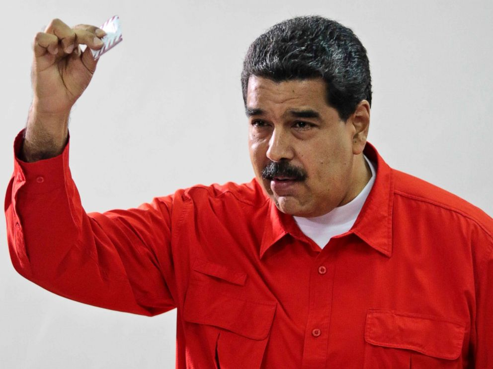 PHOTO: Venezuelas President Nicolas Maduro shows his ballot after casting a vote for a constitutional assembly in Caracas, Venezuela, July 30, 2017.
