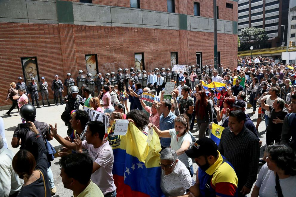 People protest during a demonstration against the government of President Nicolas Maduro called by the opposition leader self-proclaimed acting president Juan Guaido, Jan. 30, 2019, in Caracas, Venezuela.