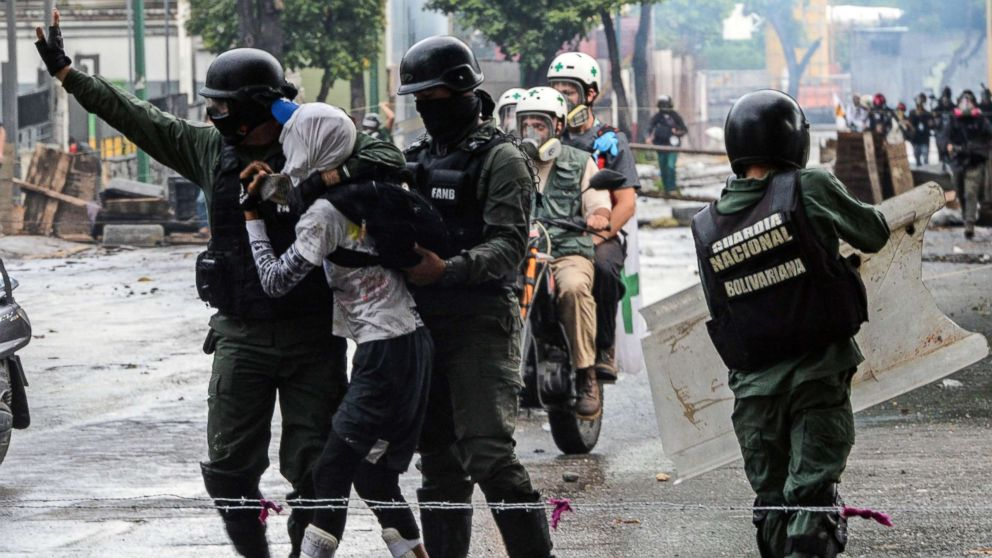 An anti-government activist is arrested during clashes in Caracas, July 28, 2017.