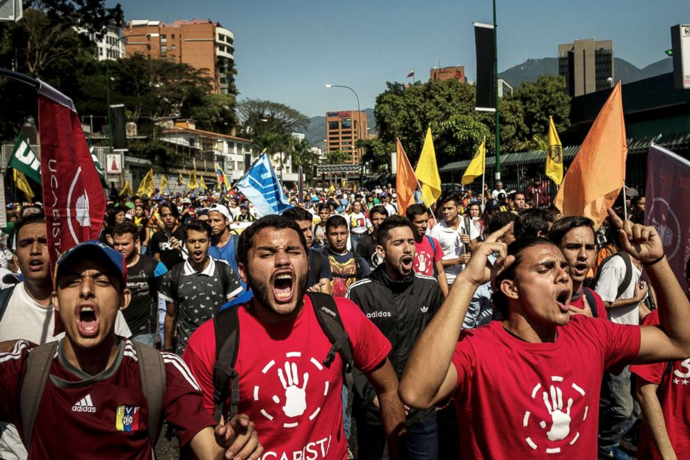 PHOTO: Venezuelan opposition supporters march in a demonstration protesting the authoritarian rule of President Nicolas Maduro of Venezuela in Caracas, Feb. 2, 2019.