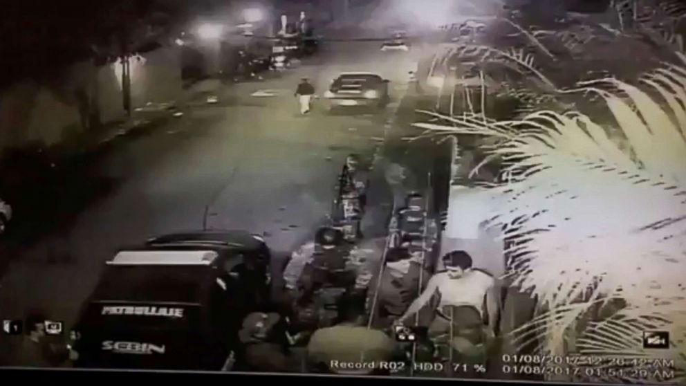 """A still image taken from a social media video is said to show the moment in which opposition leader Leopoldo Lopez is led into a vehicle marked with """"Sebin"""", Venezuela's intelligence agency, in Caracas, Venezuela, Aug. 1, 2017."""