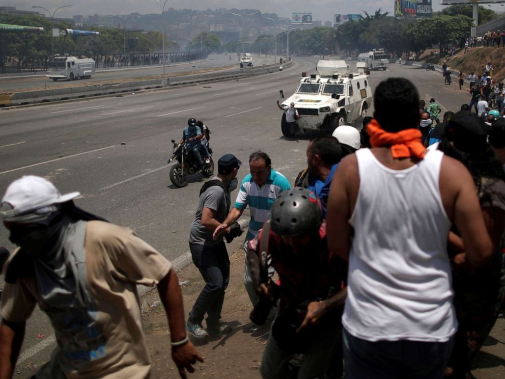 PHOTO: An opposition demonstrator is struck by a Venezuelan National Guard vehicle on a street near the Generalisimo Francisco de Miranda Airbase La Carlota in Caracas, Venezuela, April 30, 2019.