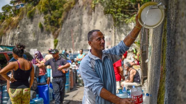 In embattled Venezuela, residents line up for hours just to get clean water: 'Look at how we are living'