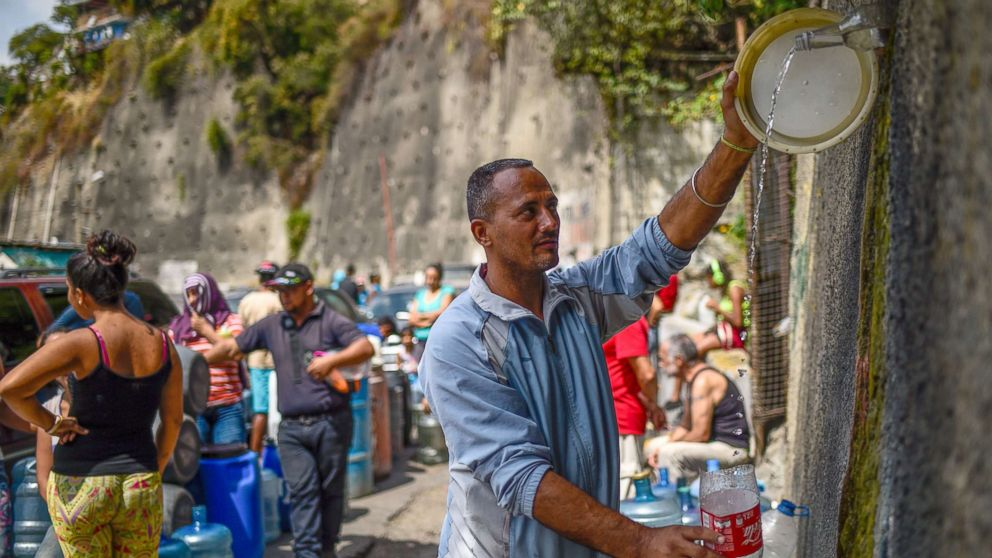 In embattled Venezuela, residents line up for hours just to get clean water: 'Look at how we are living' thumbnail