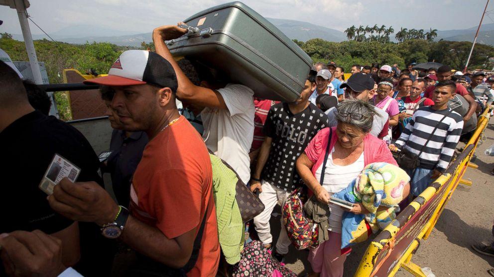 Venezuelans cross the International Simon Bolivar bridge into the Colombia, Feb. 21, 2018.