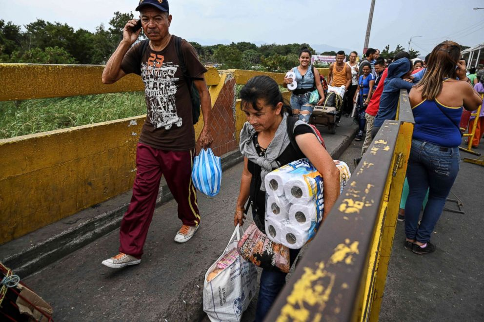 PHOTO: Venezuelans cross the Simon Bolivar brige in San Antonio del Tachira, Tachira State, Venezuela, on the border with Colombia, Feb. 20, 2019.