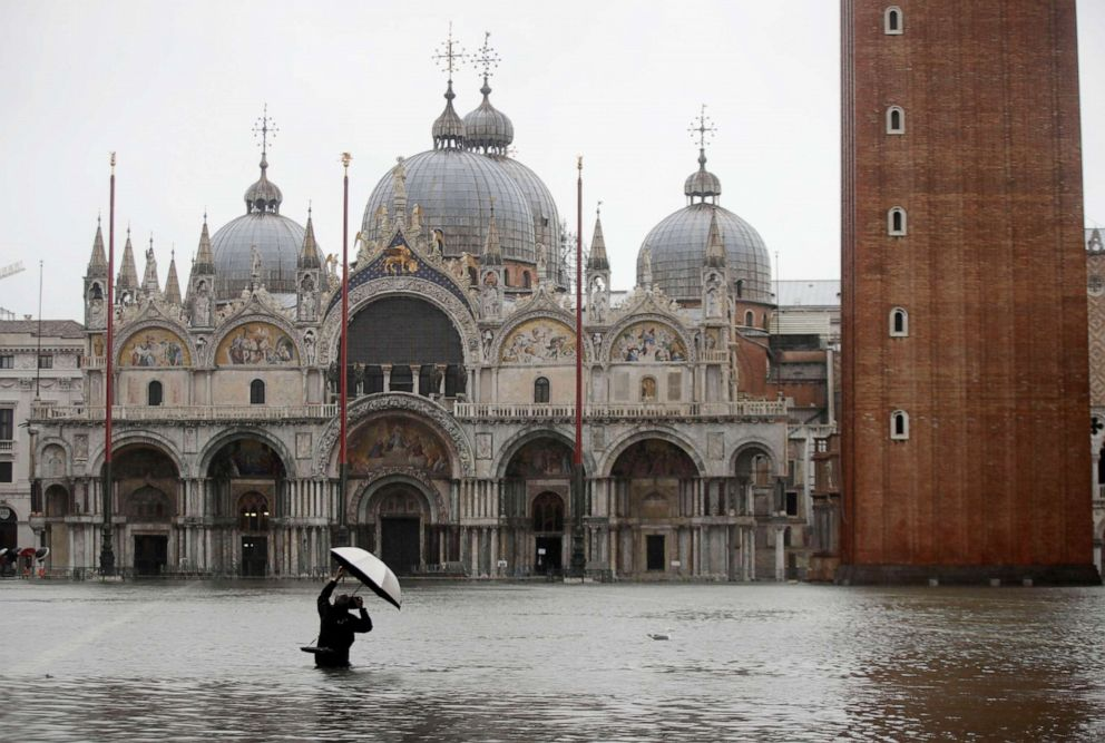 PHOTO: A photographer takes pictures in a flooded St. Marks Square, in Venice, Italy, Nov. 12, 2019.