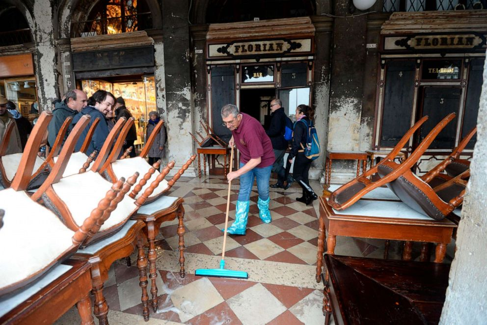 PHOTO: A man cleans water out of the historical Florian cafe, in Venice, Italy, Nov. 13, 2019.