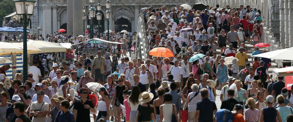 PHOTO: Tourists walks near St. Marks square in Venice, Italy, Aug. 3, 2017.