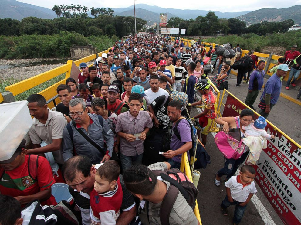 PHOTO: Venezuelan citizens cross the Simon Bolivar international bridge from San Antonio del Tachira in Venezuela to Norte de Santander province of Colombia on Feb. 10, 2018.