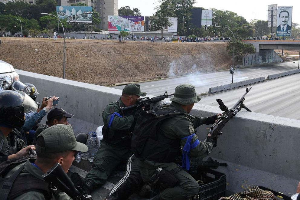 PHOTO: Soldiers loyal to Venezuelan opposition leader and self-proclaimed acting president Juan Guaido take position in front of La Carlota base in Caracas, April 29, 2019.
