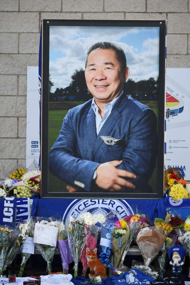 PHOTO: A portrait of Leicester City Football Clubs Thai chairman Vichai Srivaddhanaprabha, is seen with flowers and tributes outside the King Power Stadium in Leicester, England, Oct. 29, 2018.