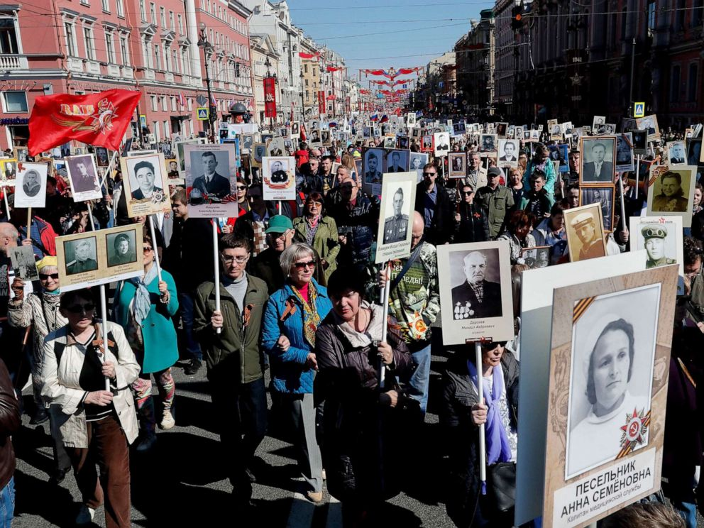 PHOTO:Russian people take part in the Immortal Regiment memorial demonstration with portraits of their relatives, who participated in World War II, in central St. Petersburg, Russia, May 9, 2019.