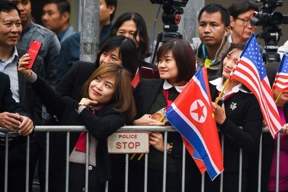 PHOTO: A woman takes a selfie as people gather around a street in Hanoi, Vietnam, Feb. 26, 2019, ahead the second US-North Korea summit.