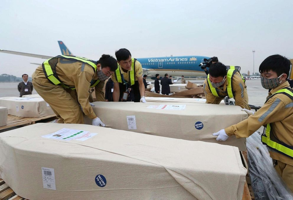 PHOTO: Coffins arrive on the tarmac of the Noi Bai airport on Nov. 27, 2019, in Hanoi, Vietnam. Media in Vietnam say the bodies of 16 of the 39 Vietnamese who died when human traffickers carried them by truck to England been repatriated to their homeland.