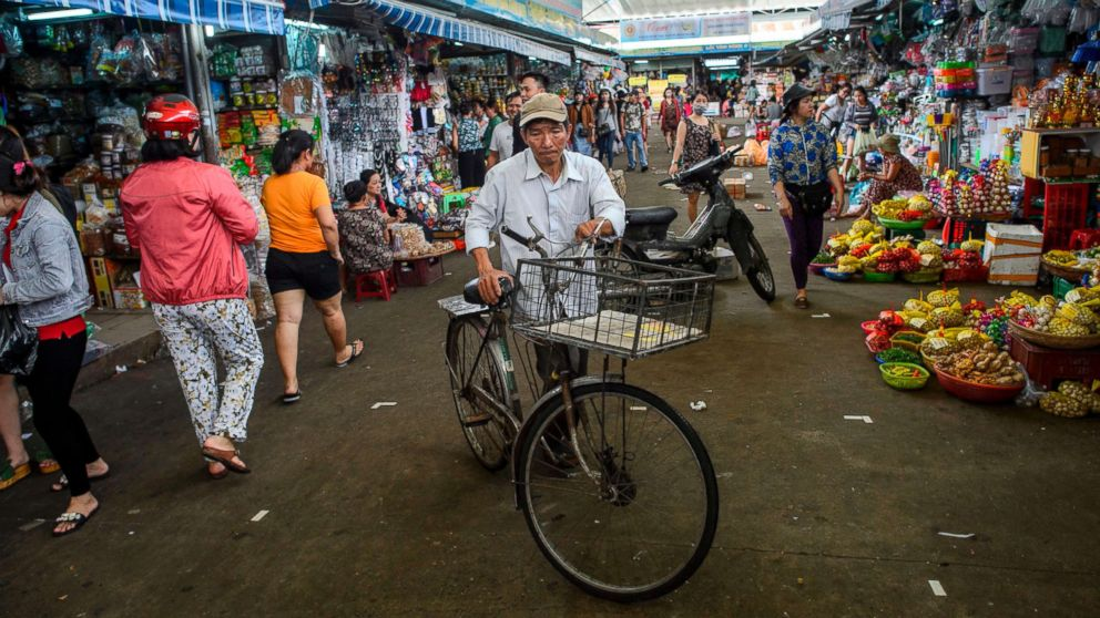 A man walks with his bicycle in the Con Market in the central Vietnamese city of Danang in this Nov. 11, 2017 file photo.