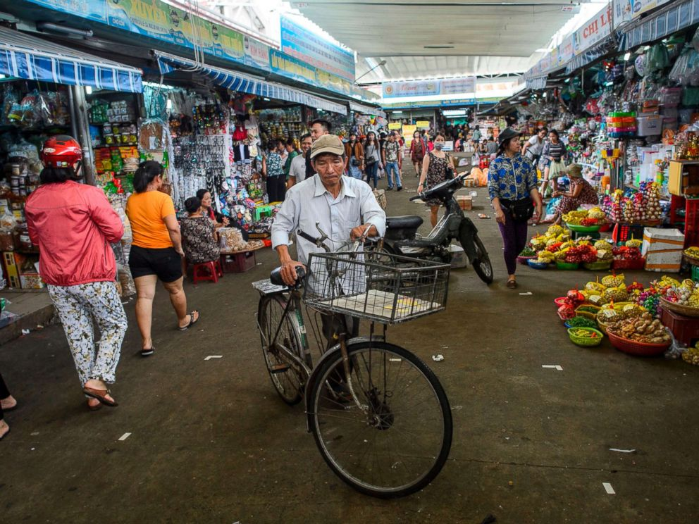 PHOTO: A man walks with his bicycle in the Con Market in the central Vietnamese city of Danang in this Nov. 11, 2017 file photo.
