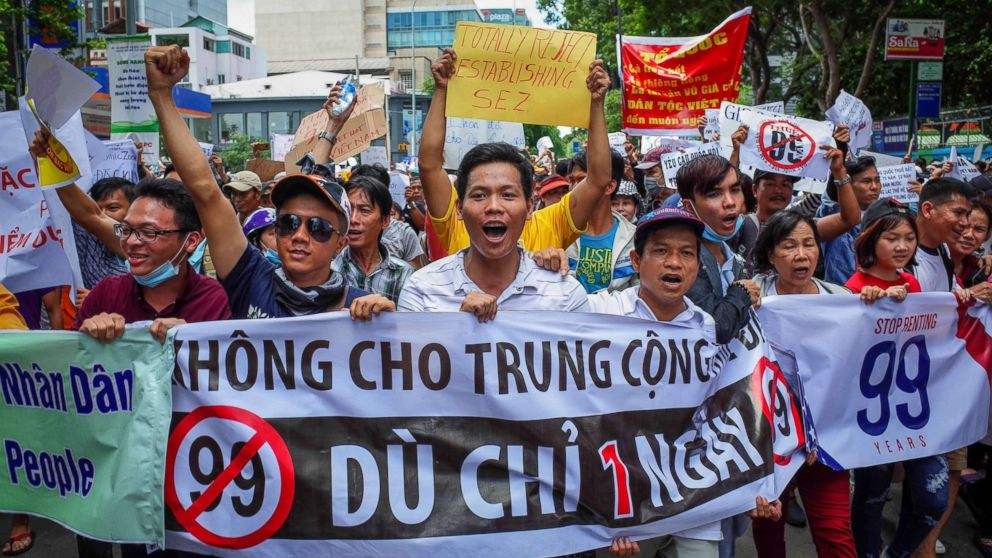 Vietnamese protesters shout slogans against a proposal to grant companies lengthy land leases during a demonstration in Ho Chi Minh City, June 10, 2018.