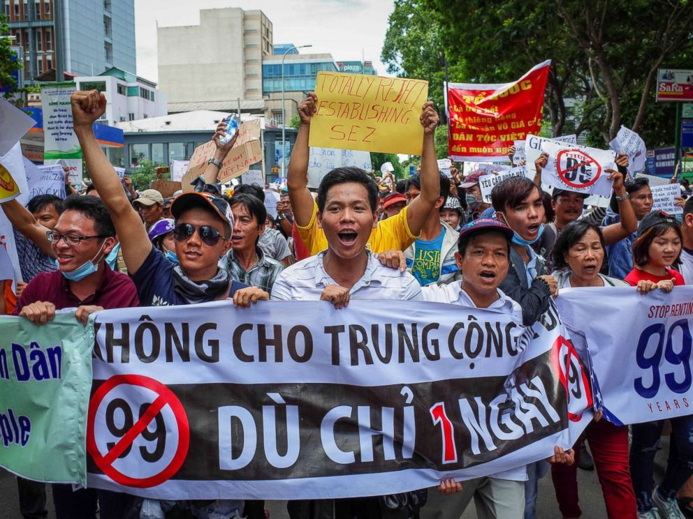 PHOTO: Vietnamese protesters shout slogans against a proposal to grant companies lengthy land leases during a demonstration in Ho Chi Minh City, June 10, 2018.  State Department 'deeply concerned' over arrest of US citizen during a protest in Vietnam vietnam protest 01 as gty 180615 hpMain 4x3 992