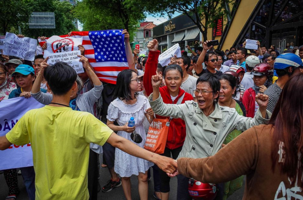 PHOTO: Vietnamese protesters shout slogans against a proposal to grant companies lengthy land leases during a demonstration in Ho Chi Minh City, June 10, 2018.  State Department 'deeply concerned' over arrest of US citizen during a protest in Vietnam vietnam protest 03 as gty 180615 hpEmbed 3x2 992