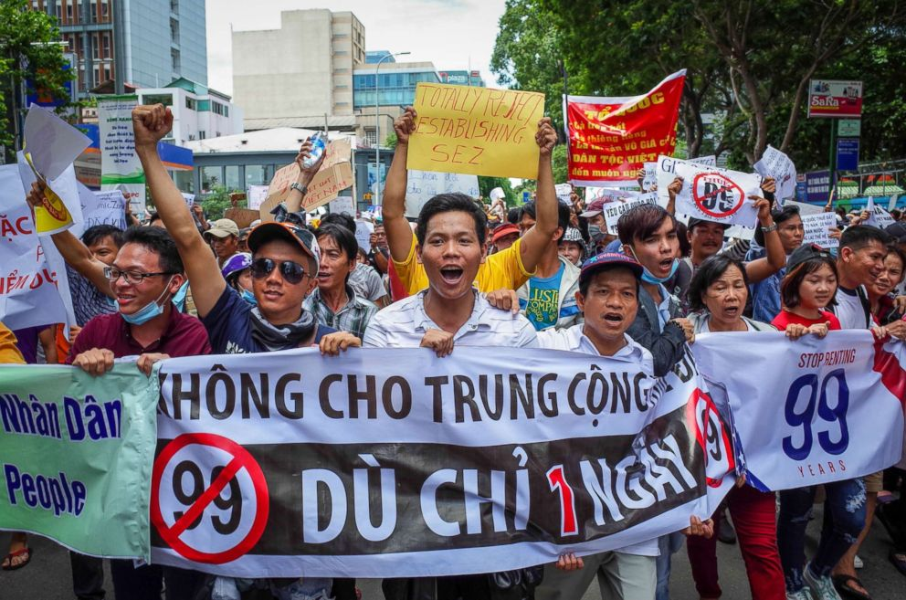 PHOTO: Vietnamese protesters shout slogans against a proposal to grant companies lengthy land leases during a demonstration in Ho Chi Minh City, Vietnam, June 10, 2018.