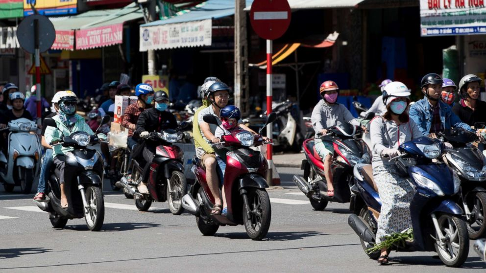 Motorcyclists travel along a road in Da Nang, Vietnam in this Nov. 11, 2017 file photo.