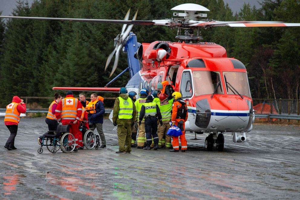 PHOTO: Passengers are helped out of a rescue helicopter after being rescued from cruise ship Viking Sky in Hustadvika, Norway, March 24, 2019.