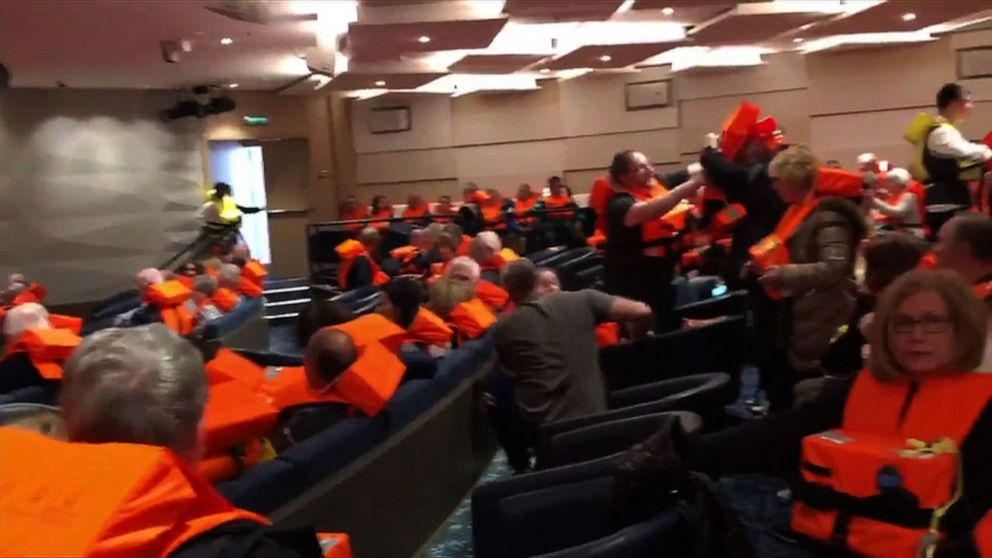 PHOTO: This image grab from a handout video made available to AFTV, March 24, 2019, by a passenger onboard the cruise ship Viking Sky shows fellow passengers gathering in a room with life jackets.